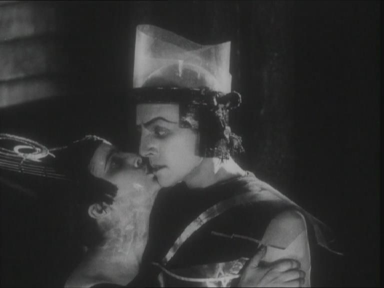This is a still from Iakov Protazanov's famous film Aelita, based on the novel of the same name by Aleksei Tolstoi. Besides being an important harbinger of a modernist aesthetic in the history of Russian cinema, the movie helped to foster a popular interest in space travel. The actress playing Aelita, the queen of Mars was Iuliia Sol'ntseva who would later come a well-known director.